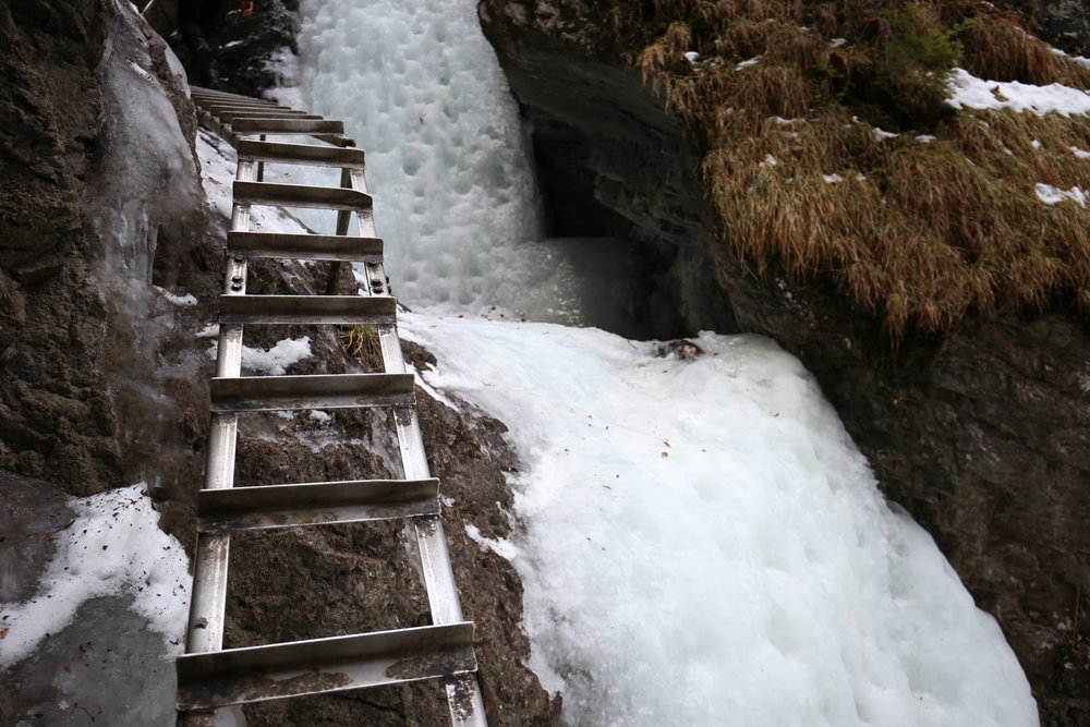 Metal ladders to hike over the frozen waterfalls in Slovak Paradise Park, in winter.
