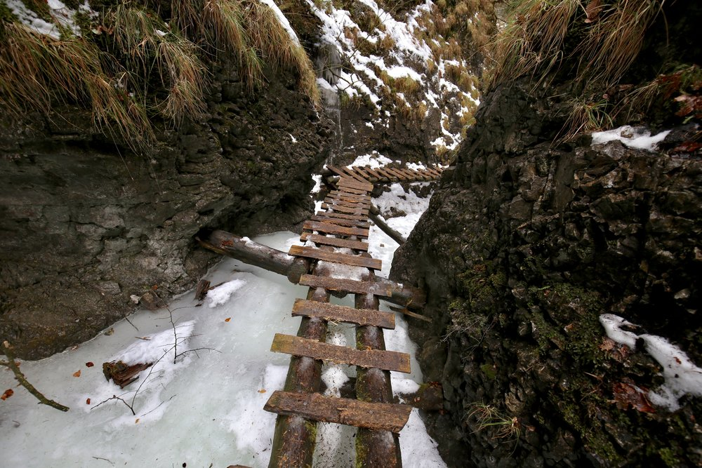 Wooden ladders to hike over frozen rivers, Slovakian National Park.