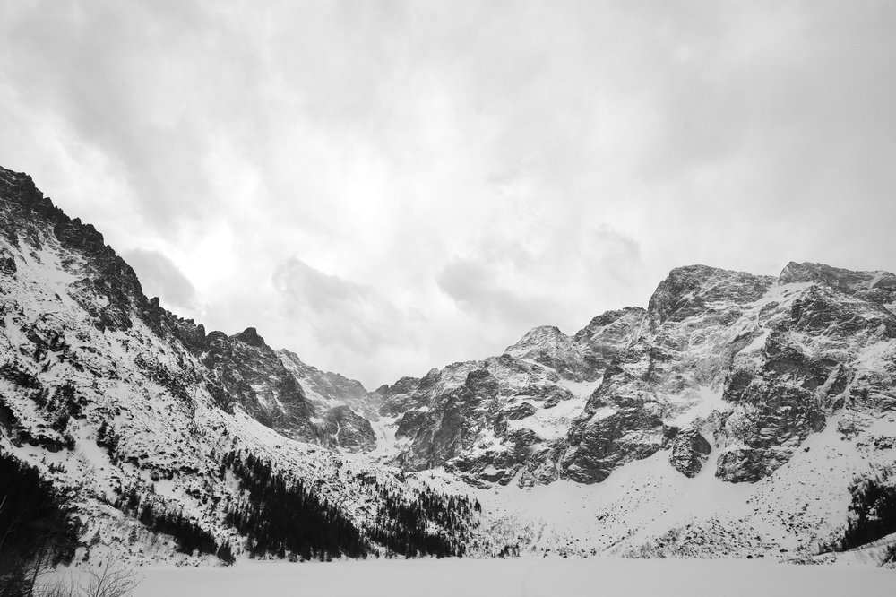 The beauty and majesty of the Tatras mountain range in winter - black and white photography, Poland.