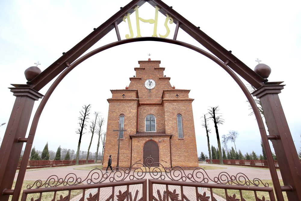 The red brick church of Zalipie, Poland. Seen from the front gate.