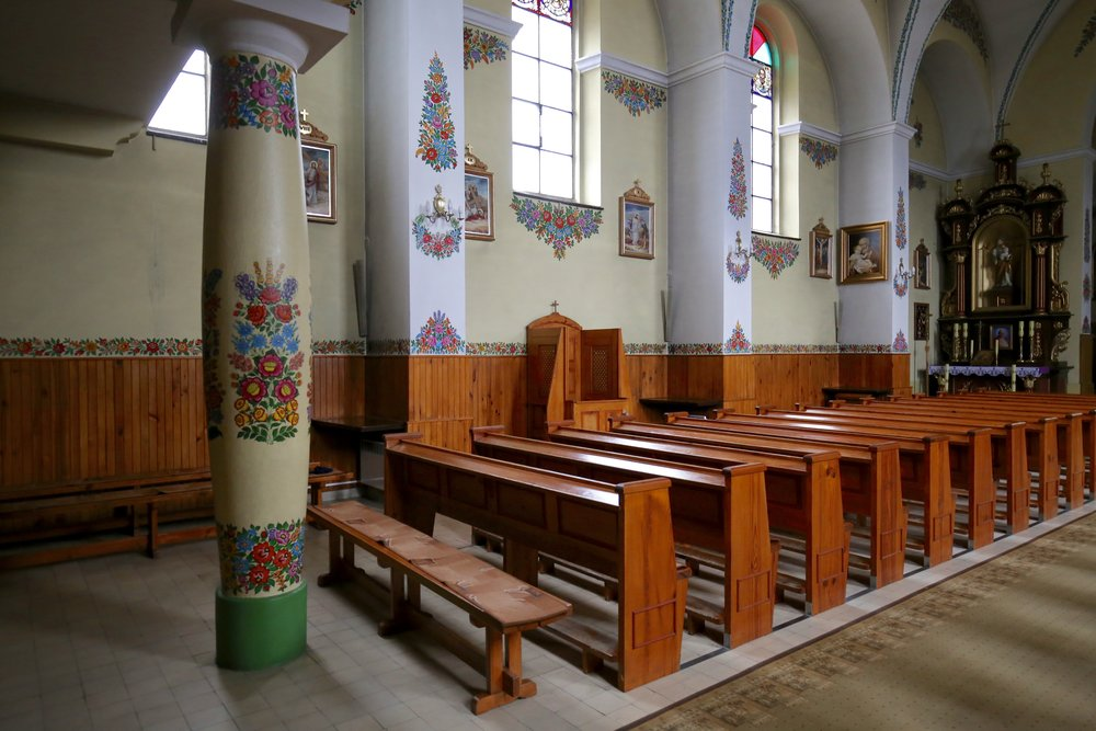 The beautiful church interior of Zalipie - all painted with wreaths of flowers, and the old wooden pews.