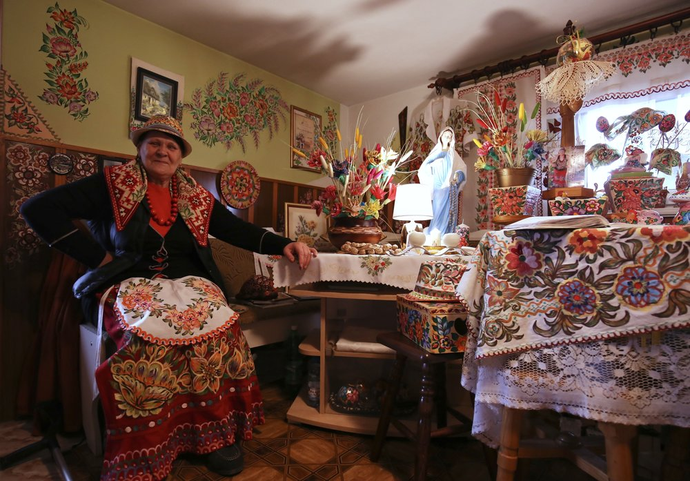 An old lady who lives in a painted house, with her traditional clothes, in Zalipie, Poland.
