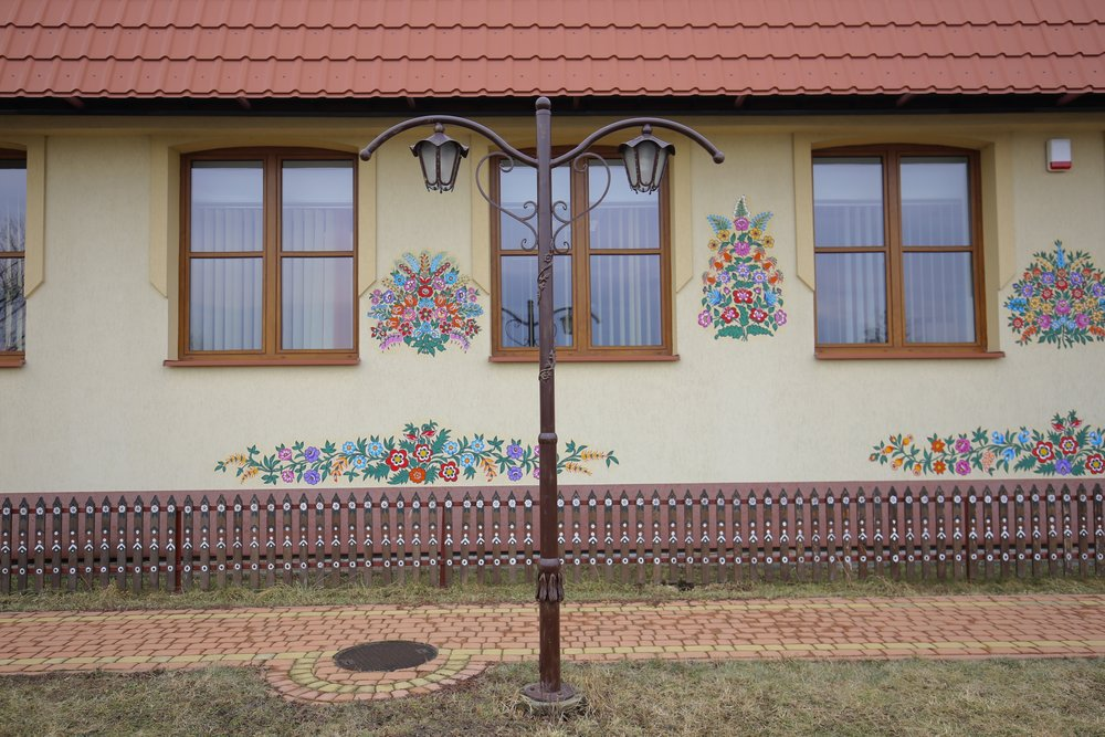 Flower fences at the local school of Zalipie, Poland.