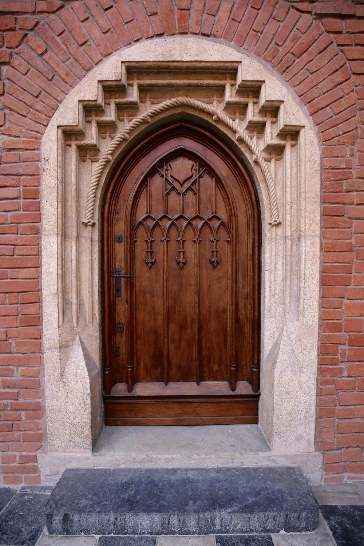 A little wooden door, of ancient make, in the University of Krakow.