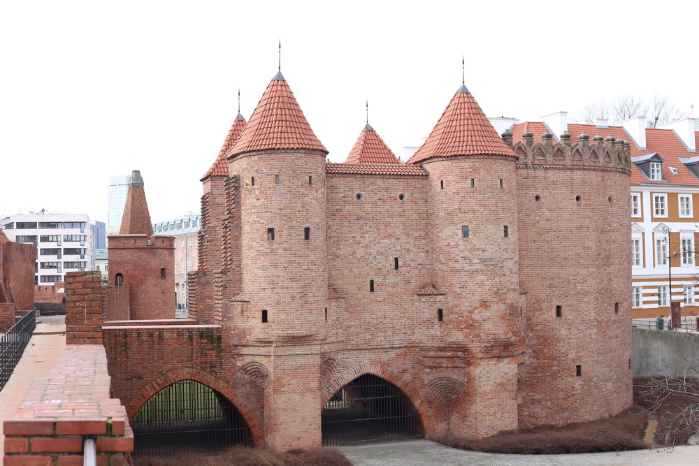 What looks like a small red castle - the medieval city gates of Warsaw in Poland.