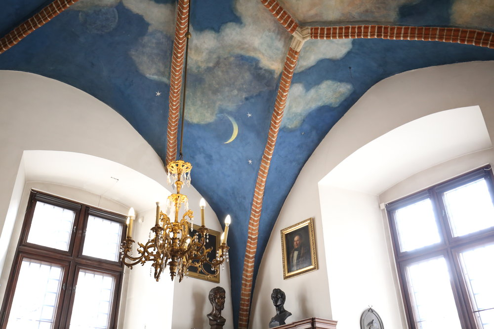 Sky painted ceilings - with white clouds and blue patches, in the medieval hallways of Krakow's Univeristy.