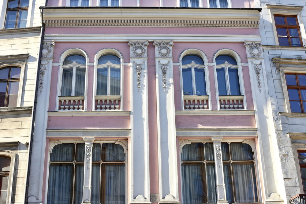 A pink façade on a grand old polish building.