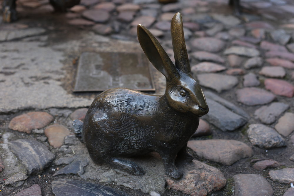 Small bronze rabbit in Wroclaw.