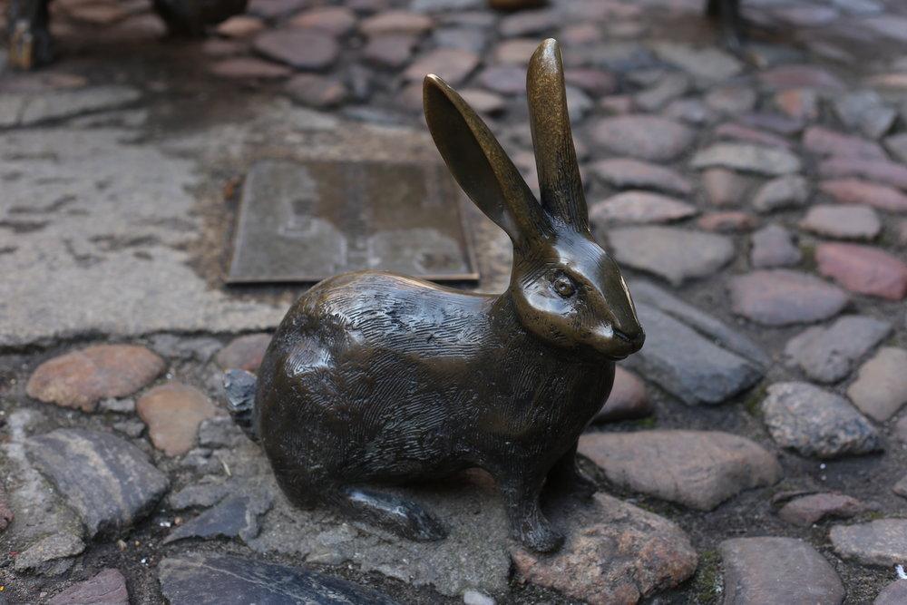 Small bronze rabbit in Wroclaw.
