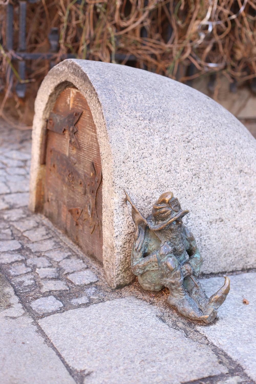Sleeping dwarf by a tiny hobbit hole - Wroclaw