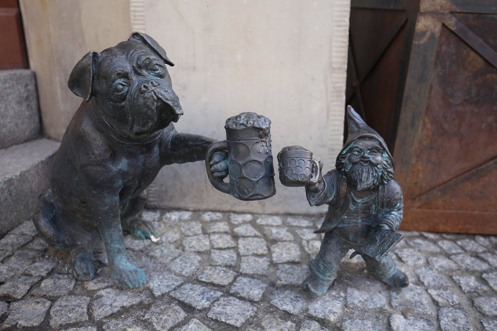 Dwarf and a dog drinking beer - Wroclaw.
