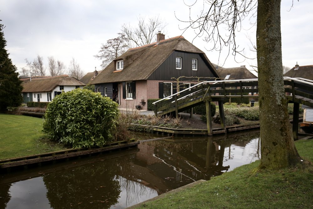Cute and sweet little cottages by the canals of Giethoorn, the Netherlands.