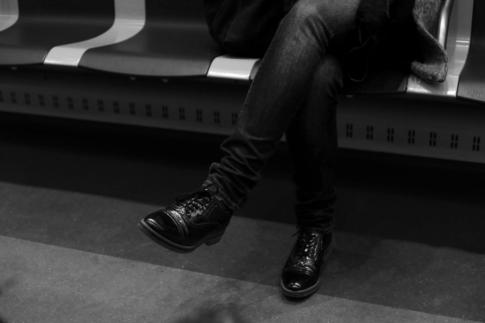 Cool leather shoes of a stranger on the train, Amsterdam.