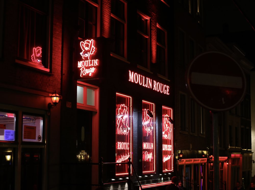 The Moulin Rouge - red light buildings in Amsterdam at night.