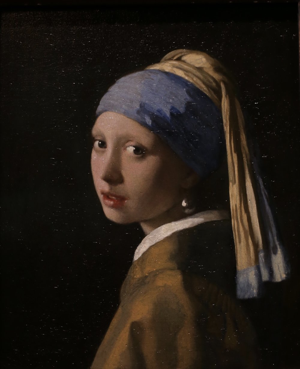 The Girl With the Pearl Earring - by Johannes Vermeer.