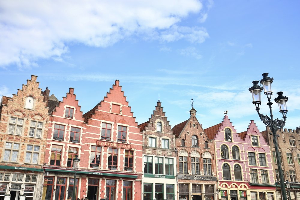 Colourful town houses in a row in the market place of Bruges.