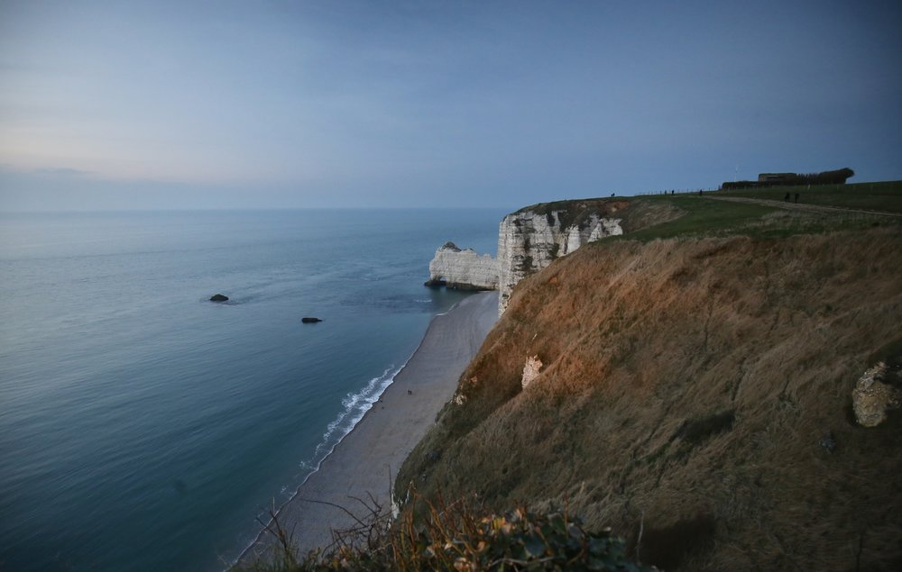 The beautiful white cliffs and natural arches of Falaises d'Etretat.