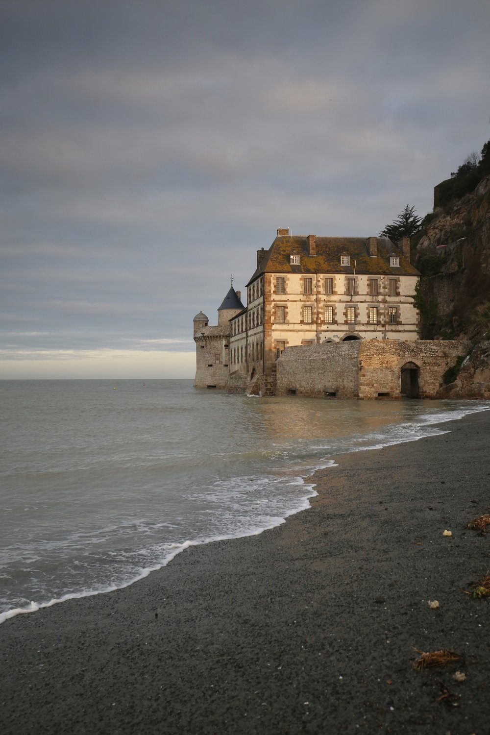 The walls of Mont Saint Michel at high tide - so gorgeous with the sea shore.