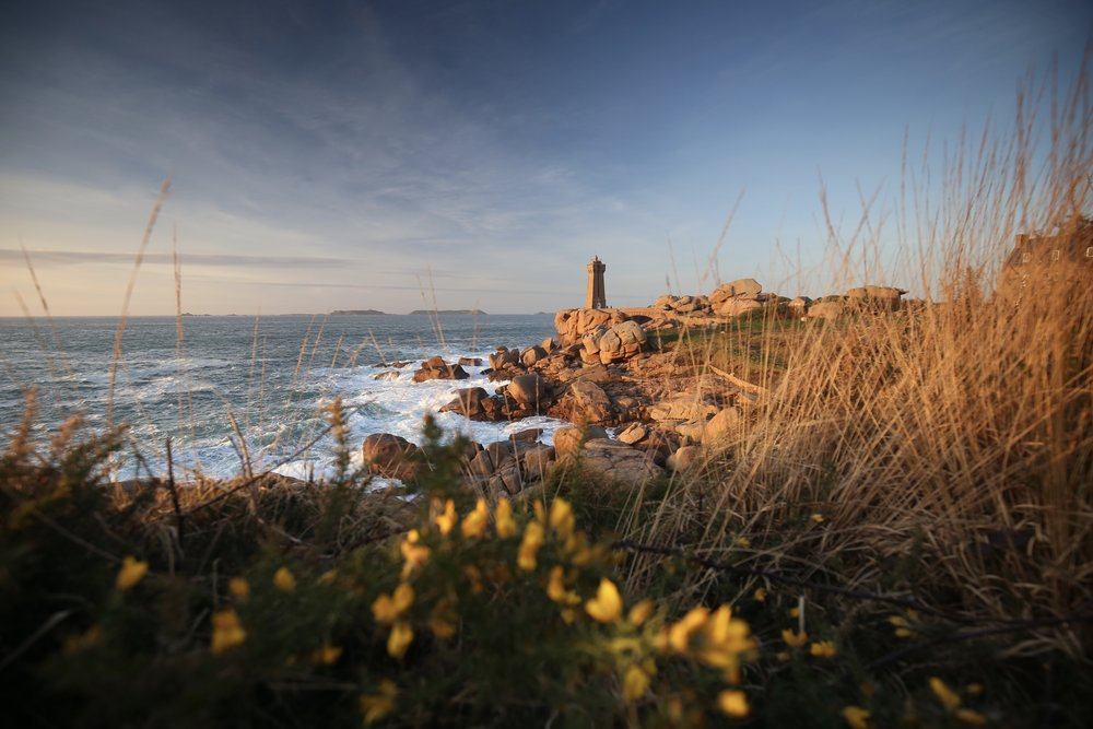 The lighthouse at Ploumanach on the Cote de Granit Rose, France - at sunset.