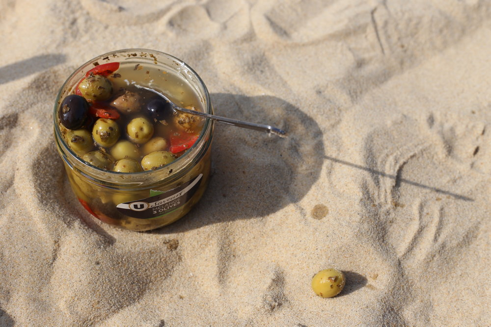 A jar of olives - picnicking on the sand dunes.