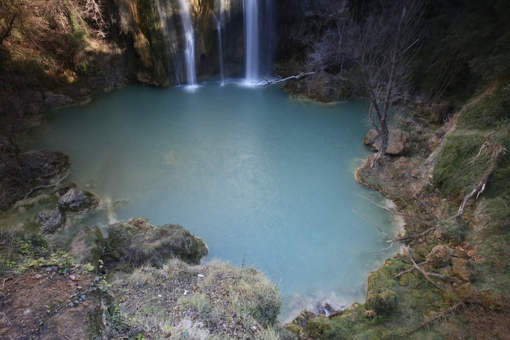 The blue green pool of Sillans La Cascade in the national parks of France.
