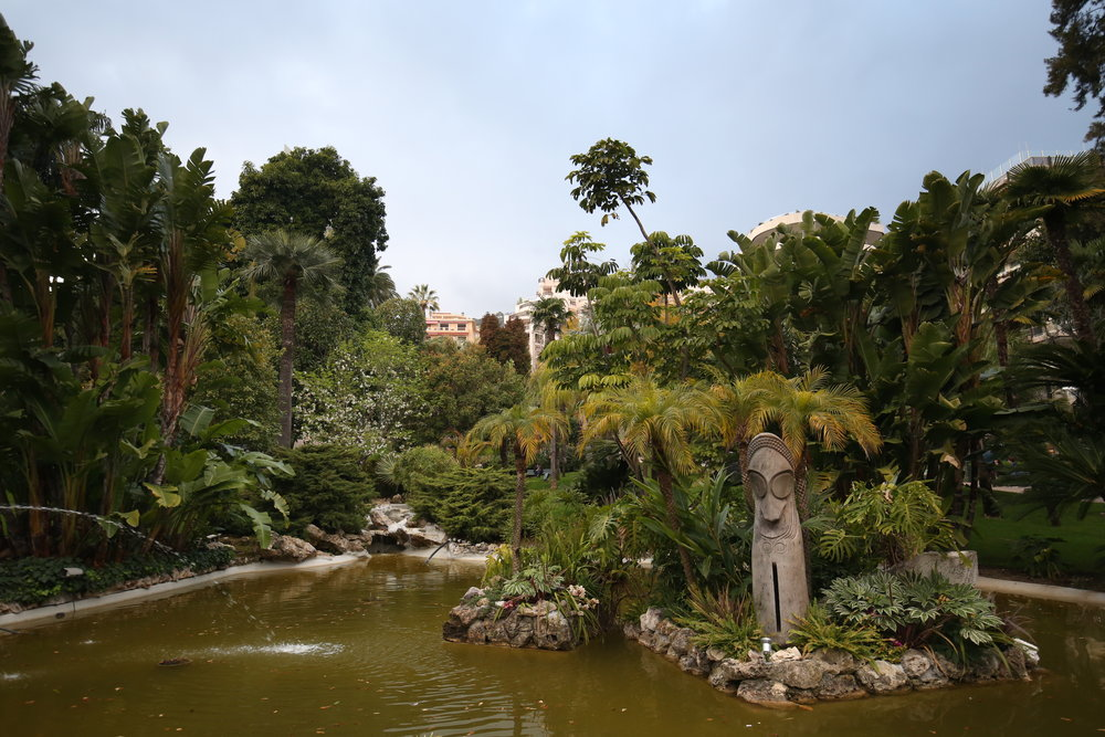 The Casino Gardens in Monaco - all palm leaves and green water.