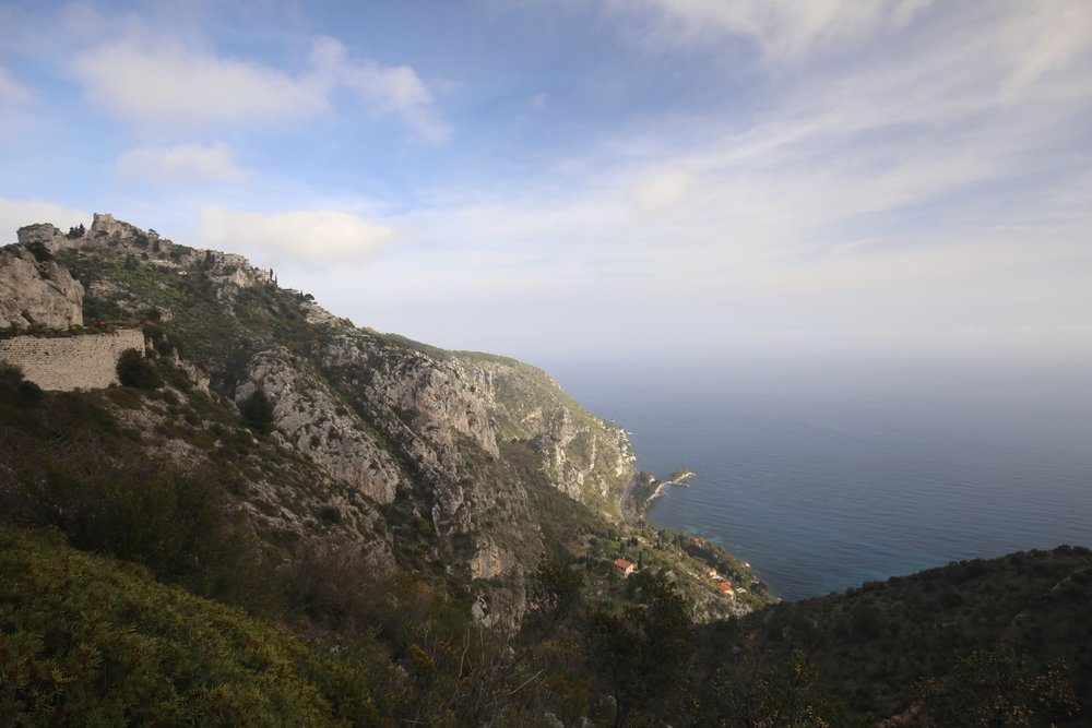 Driving the hills around Monaco with gorgeous views of the blue ocean and lush forest.