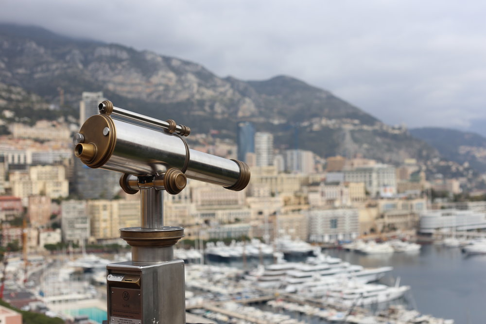 A silver and gold telescope on the hillsides of Monaco.