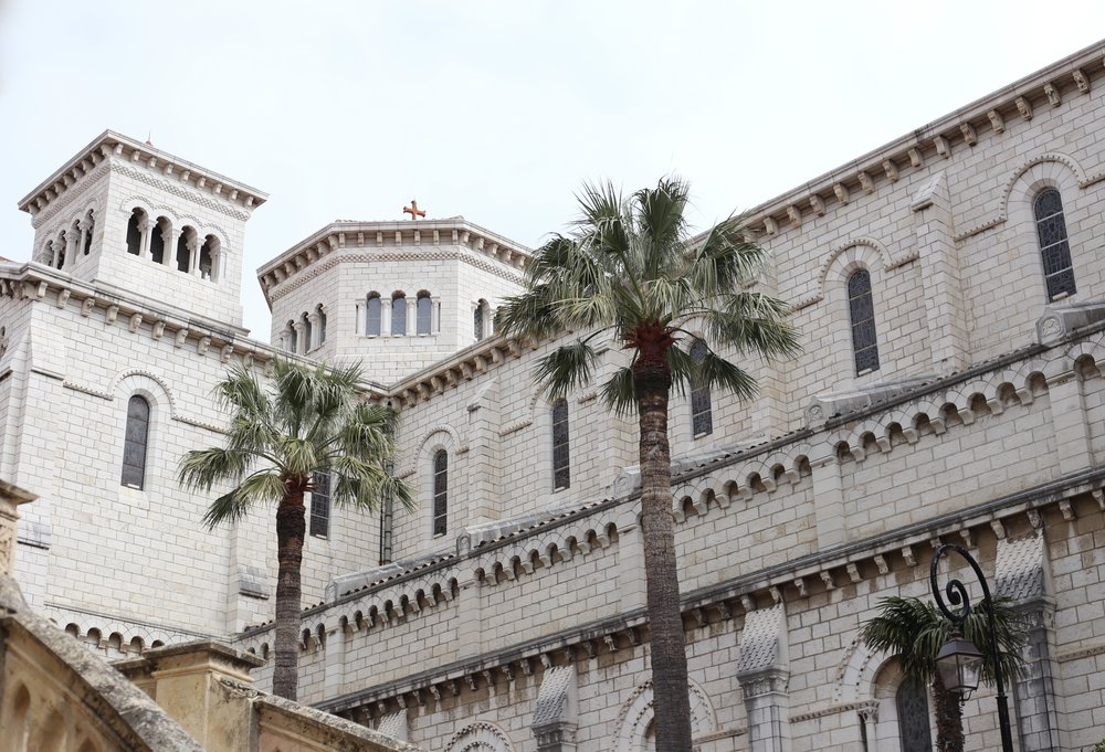A regal white stone building, with exotic palms, Monaco.