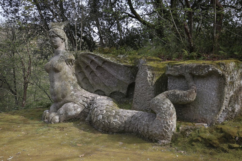 A winged serpent goddess at in the Garden of Monsters.