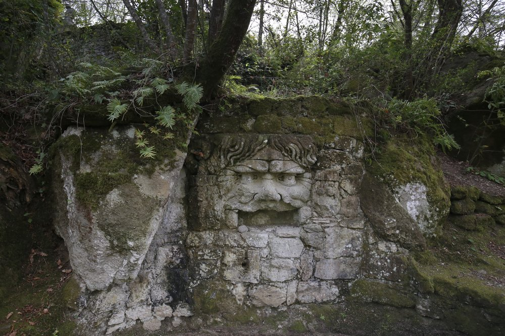 A face amongst the moss and stones - medieval Garden of Monsters.