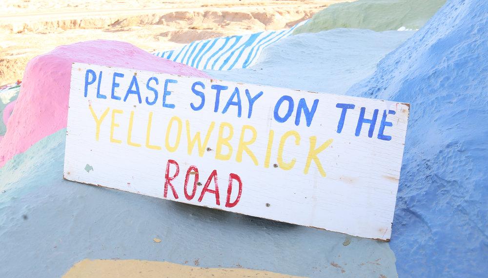 yellow-brick-road-sign