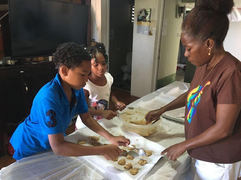 Kids help prepare cookies