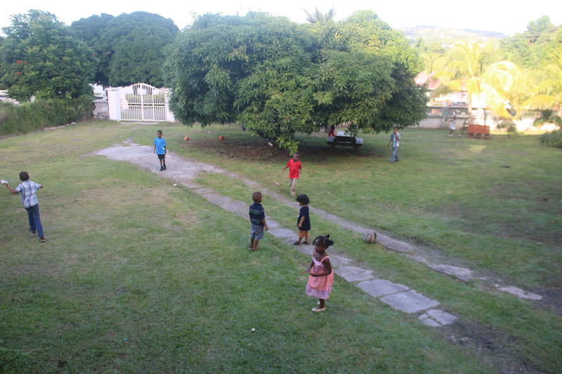 Kids Play on the lawn at the YWAM base