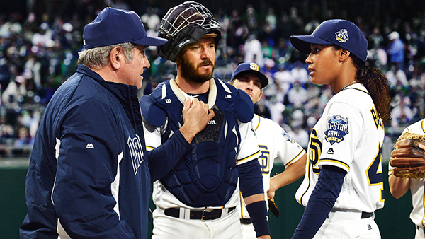 Ginny Baker (Kylie Bunbury, right) having a chat on the mound with coach Al Luongo (Dan Lauria, left) and catcher Mike Lawson (Mark-Paul Gosselaar, middle).