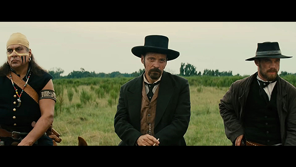 Bartholomew Bogue (Peter Sarsgaard, center) receives slightly more focus than films prior, as do his lieutenants Denali (Jonathan Joss, left) and McCann (Cam Gigandet, right).