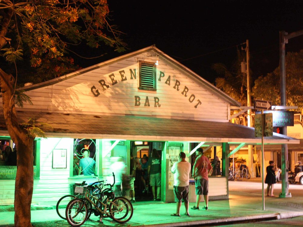 Green Parrot Bar Entrance at Night