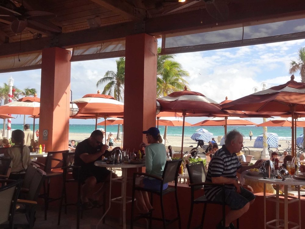 Latitudes Tiki Bar Indoor Dining Area and Beach View
