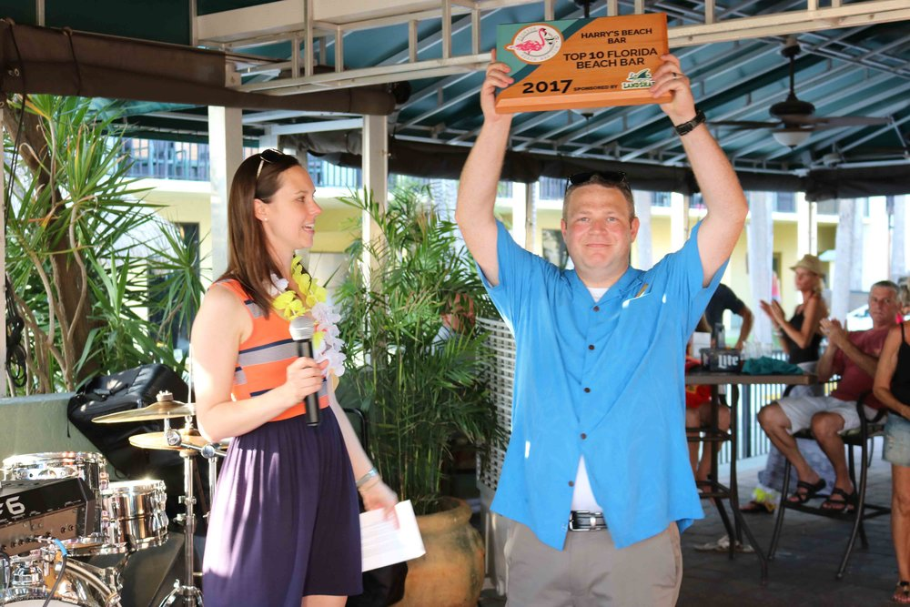 Chris, the General Manager, accepts the 2017 Top Florida Beach Bar award.