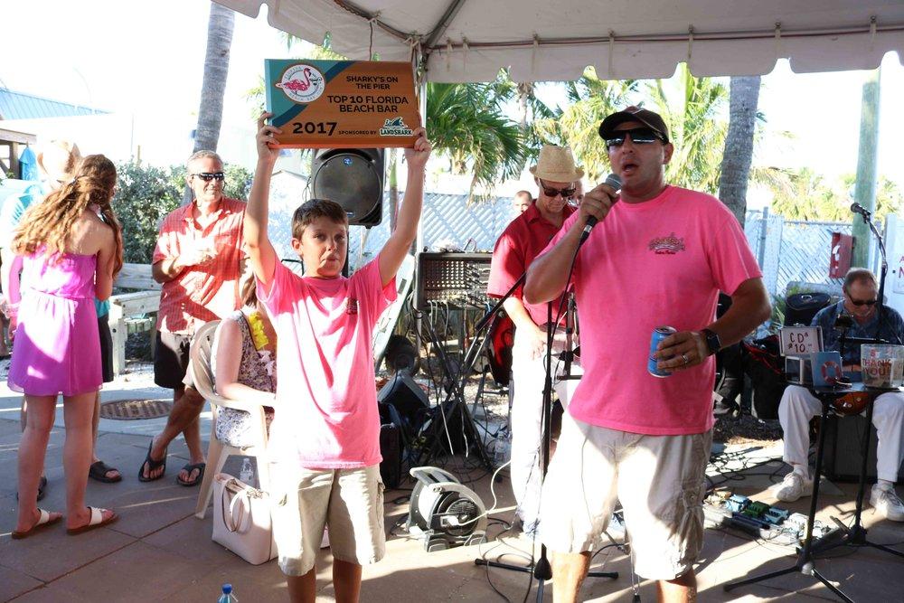 Justin and his son accept the 2017 Top 10 Florida Beach Bar Award