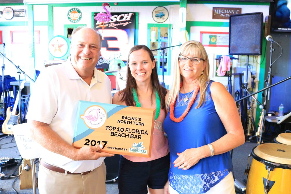 Racing's North Turn Owners, Walt and Rhonda, accept the 2017 Top 10 Florida Beach Bar award
