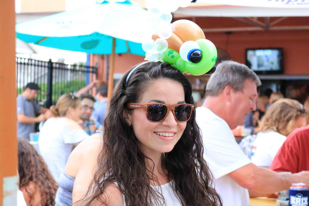 'twist of fun balloon art'  made some great balloon animal hats at the lemon bar