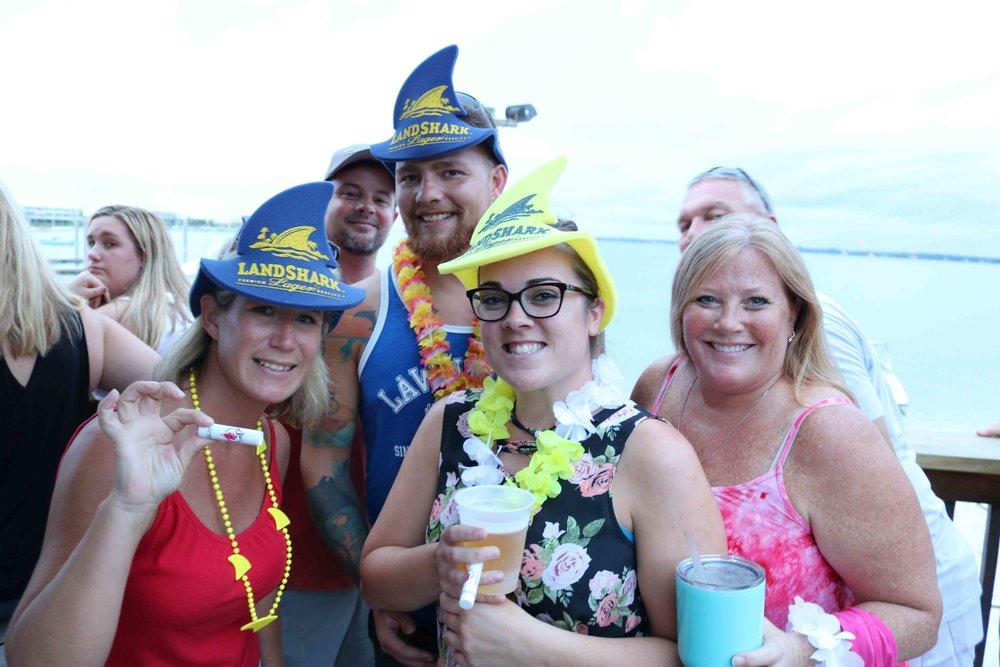 celebrating with landshark gear at juana's pagodas top florida beach bar party