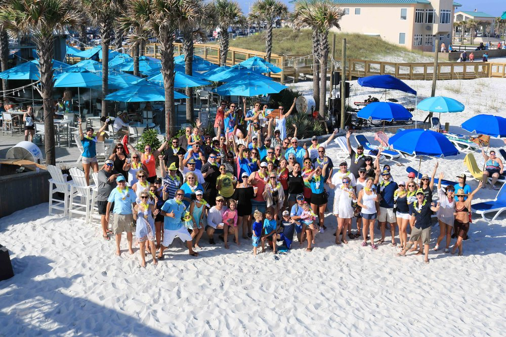 group photo of staff and guests at casino beach bar's award party