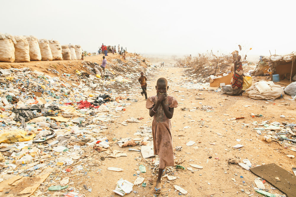 Living in Trash to Survive a Civil War: Juba, South Sudan   - After driving on countless unpaved roads about 15 km west of Juba, we arrived at the Juba County Dumpsite. Smoke and methane gas were steaming from the waste-covered earth.
