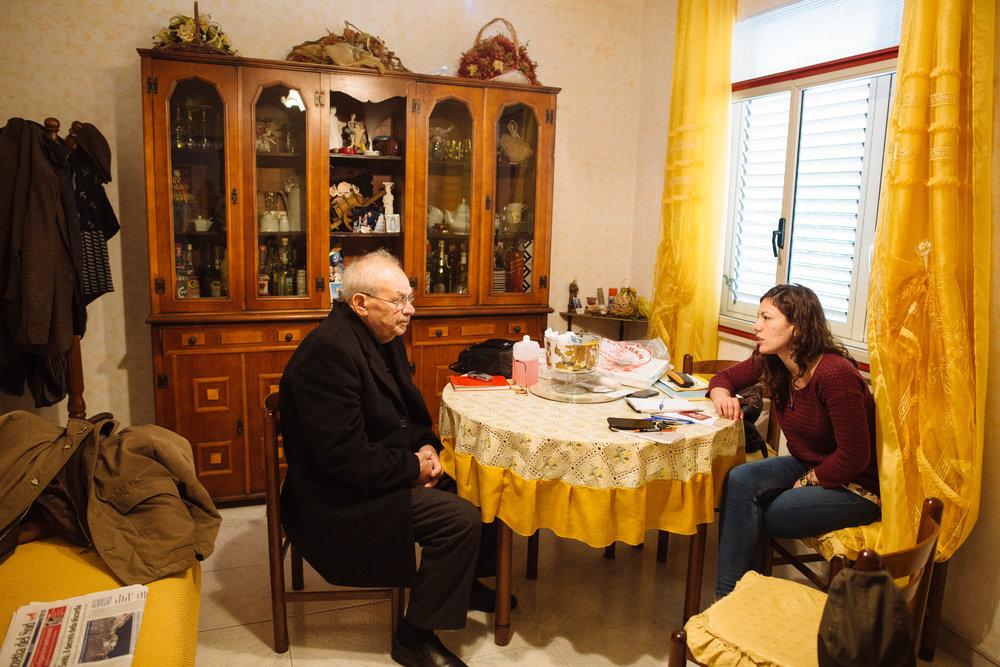 Sitting down with Salvatore Siviglia and Olimpia Squillaci in Salvatore's home in Roghudi Nuovo.