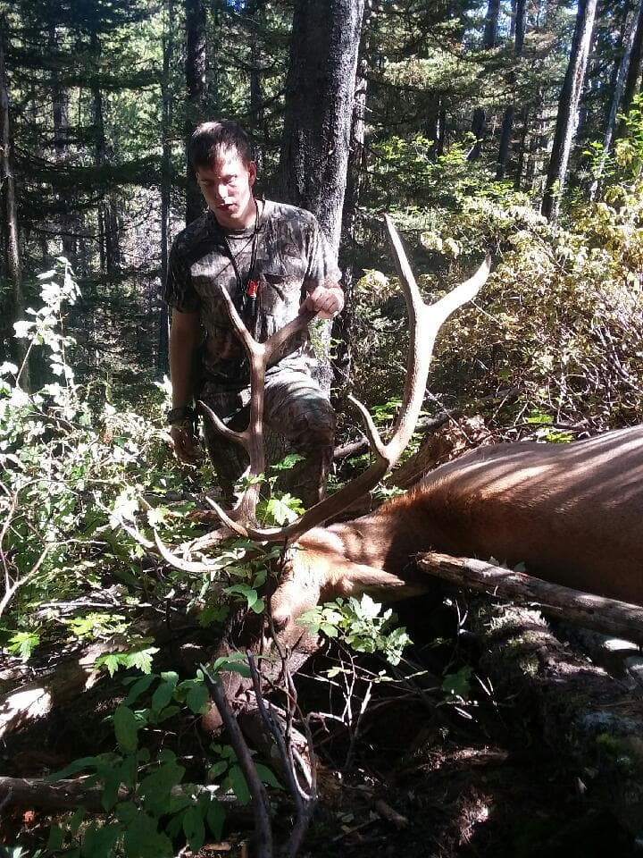Josh standing in reverence with his 2018 archery bull