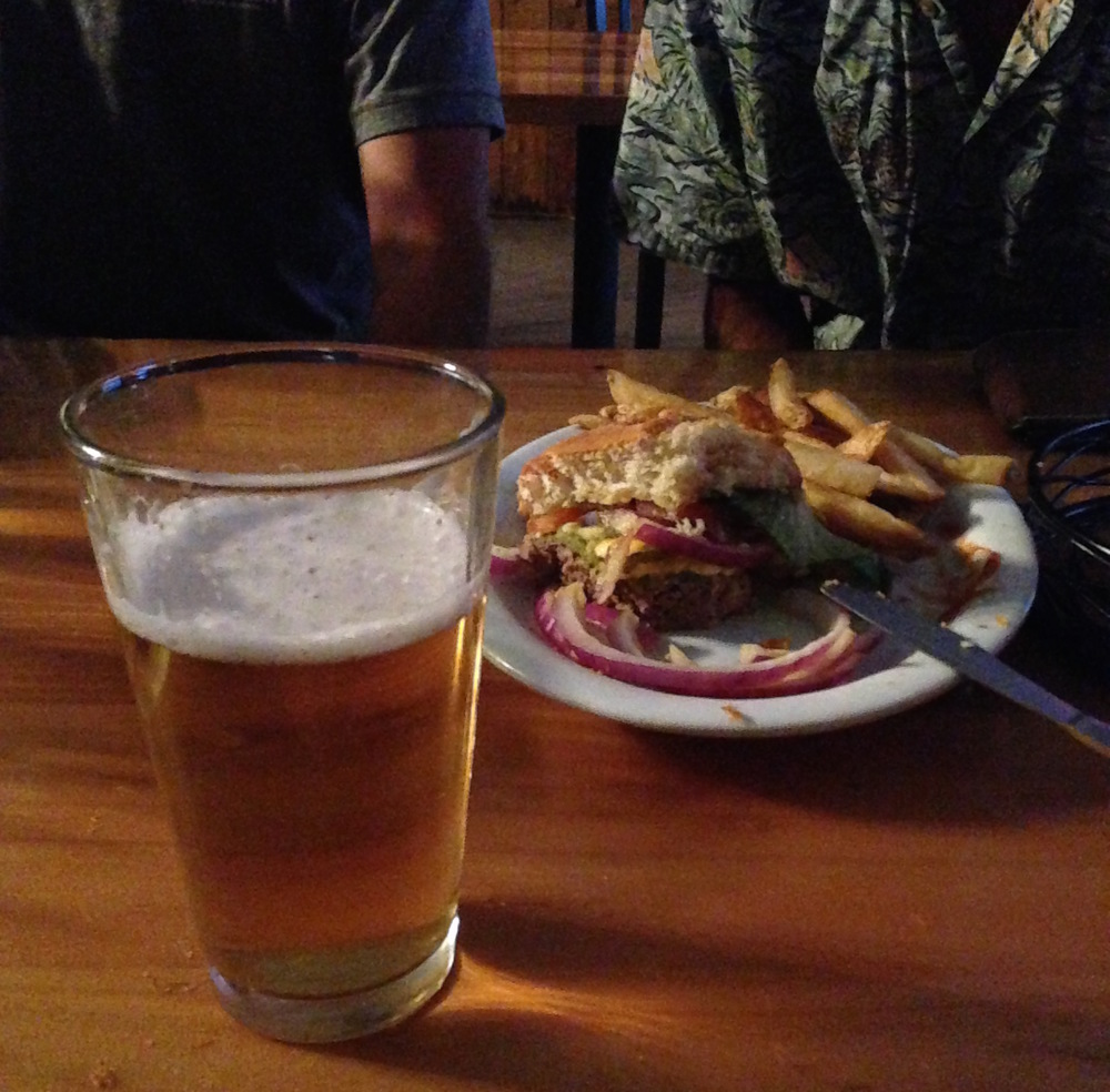 Yet another incredibly poor photograph at Packer's. You can see the remainder of that burger in the background and what was probably my third beer in front. Dudes in the far back.