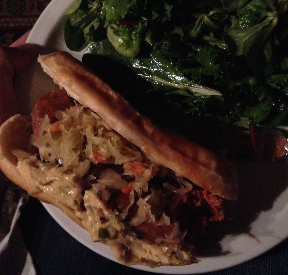 Sausage, sauerkraut, and salad made with pork fat dressing. All eaten in a very dimly lit living room, obviously.