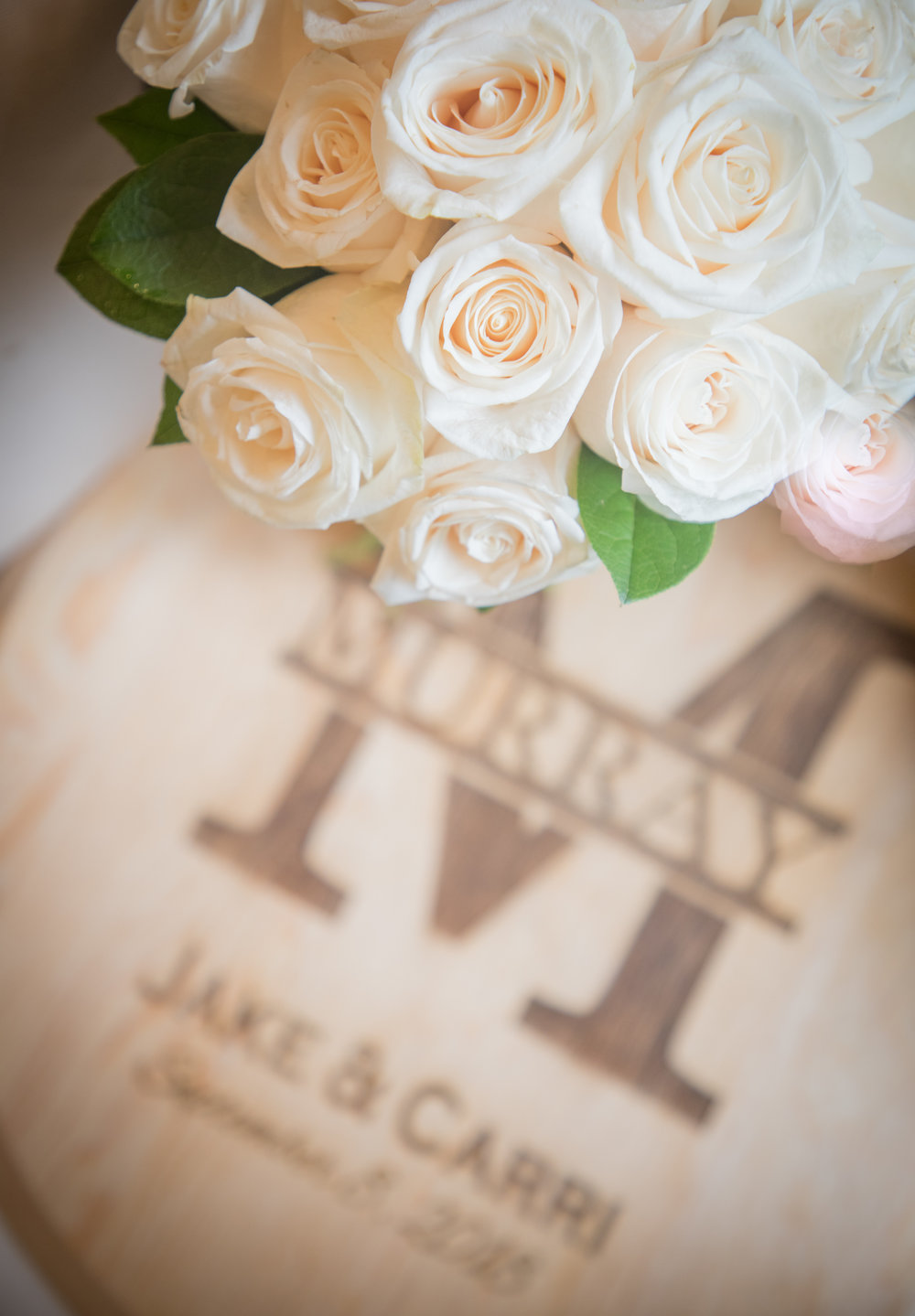 The bride and groom used an engraved wooden plaque instead of a guest book so that it could be displayed in their home.